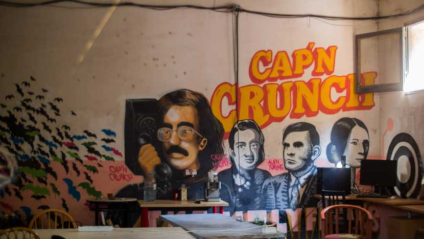 Cap'n Crunch (the 1970's telephone hacker) graffiti in a Calafou building