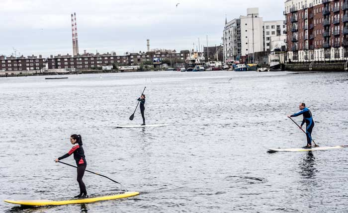Stand up paddle boarding, Grand Canal Dock Dublin, Ireland